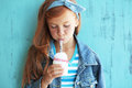 Redheaded child cute drinking milk on vintage blue background Royalty Free Stock Photography