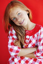 Redheaded child cute on red background Stock Image