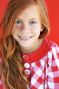 Redheaded child cute on red background Royalty Free Stock Photo