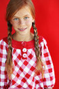 Redheaded child cute on red background Stock Photography