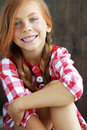 Redheaded child cute on vintage brown background Stock Photos