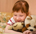 Redheaded child with teddy bears Royalty Free Stock Images
