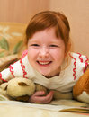 Redheaded child with teddy bears Royalty Free Stock Image