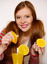 Redheaded  girl with orange Stock Photo