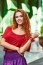 Redheaded smile woman. sunlight city portrait Royalty Free Stock Photo