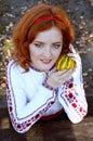 Redheaded ukraininan girl sitting at the table ukrainian in village Stock Photo