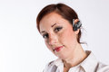 Redheaded woman with bluetooth earpiece a young business a Stock Photo
