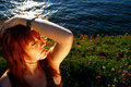 Redheaded woman near sea Royalty Free Stock Photos