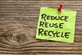 Reduce reuse and recycle note reminder against grained wood resource conservation concept Royalty Free Stock Images
