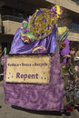Reduce reuse recycle and repent sign asheville north carolina usa january mardi gras parade float with large colorful Royalty Free Stock Image