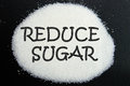 Reduce sugar written on over black background Royalty Free Stock Images