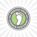 Reduce your carbon footprint icon with green environment foot badge
