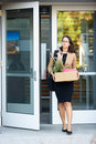 Redundant businesswoman leaving office with box Royalty Free Stock Image