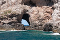 Reef cave window in rock cliff just above sea level Stock Photo
