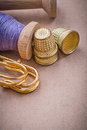 Reels of sewing threads thimbles safety pins on vintage backgrou Royalty Free Stock Photo