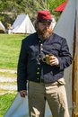 A Reenactor Drinking Coffee at an Encampment Royalty Free Stock Photo