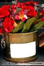 Ref flowers in metal basket Royalty Free Stock Photos