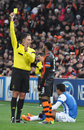 Refe shows an yellow card photo was taken during the match between shakhtar donetsk ukraine real sociedad san sebastian spain efa Stock Photo