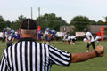 Referee checking the line Royalty Free Stock Photo