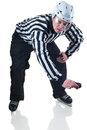 Referee on face off position hockey holding a puck in side view white background with shadow Royalty Free Stock Image