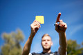 Referee on football field showing yellow card Royalty Free Stock Photo