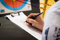 Referee keeping score in archery tournament Royalty Free Stock Images