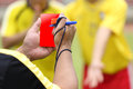 Referee soccer recorded player foul in the game Royalty Free Stock Photography
