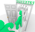 Referrals customers walking through store door doorway and marching after being referred by friends and family to visit a and Royalty Free Stock Images