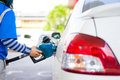 Refill fuel to a car at gas station in thailand sony mp Royalty Free Stock Images