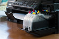 Refillable ink tanks of a inkjet printer Royalty Free Stock Photo