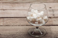 Refined sugar in cubes in glass capacity the on a wooden background from old boards nobody Stock Photography