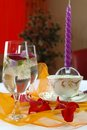 Refined table wineglass and candle on a Royalty Free Stock Photo