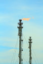 Refinery fire gas torch over blue sky Royalty Free Stock Photo