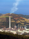 Refinery smokestack polluting Stock Photography
