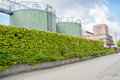 Refinery wth tanks and ivy wall Stock Images