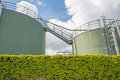 Refinery wth tanks and ivy wall Royalty Free Stock Photo