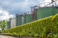 Refinery wth tanks and ivy wall Stock Photos