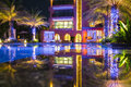 Reflect hua hin in the night with building on water Stock Photo