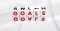 Reflecting on goals in life text red uppercase letters inscribed small white cubes placed a surface bright background Stock Images