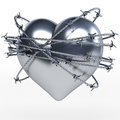 Reflecting steel, metal heart surrounded by shiny barbwire Royalty Free Stock Photo