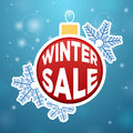 Reflection on the ball winter sale snowflake blue background Royalty Free Stock Image