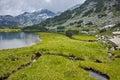 Reflection of Banderishki chukar peak in Muratovo lake, Pirin Mountain Royalty Free Stock Photo