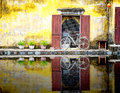 A reflection of a bicycle in hoi an the canal by the old japanese bridge vietnam Stock Images
