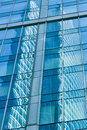 Reflection in blue glass wall of modern office building Royalty Free Stock Photo