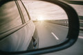 Reflection in the car rear view mirror and the road light. Royalty Free Stock Photo