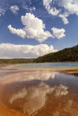 Reflection of clouds in Grand Prismatic spring in the Midway Geyser Basin in Yellowstone National Park Royalty Free Stock Photo