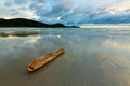 Reflection of clouds on wet sand at a beach in sabah borneo malaysia Stock Photo