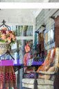 Reflection and display in shop in Key West that is an old house with the porch converted to a glassed in show room containing funk Royalty Free Stock Photo