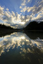 Reflection of dramatic clouds with sunrays at sabah malaysia Royalty Free Stock Images