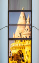 Reflection of Fisherman`s Bastion, aka Halaszbastya, fairy tale towers in modern hotel windows. Architectural contrast Royalty Free Stock Photo